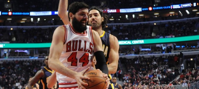 Mar 18, 2015; Chicago, IL, USA;  Chicago Bulls forward Nikola Mirotic (44) grabs a rebound in front of Indiana Pacers forward Luis Scola (4) during the first half at the United Center. Mandatory Credit: David Banks-USA TODAY Sports