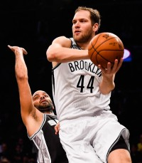 NEW YORK, NY - DECEMBER 03:  Bojan Bogdanovic #44 of the Brooklyn Nets dribbles past Tony Parker #9 of the San Antonio Spurs in the first half at the Barclays Center on December 3, 2014 in the Brooklyn borough of New York City. NOTE TO USER: User expressly acknowledges and agrees that, by downloading and/or using this photograph, user is consenting to the terms and conditions of the Getty Images License Agreement.  (Photo by Alex Goodlett/Getty Images)