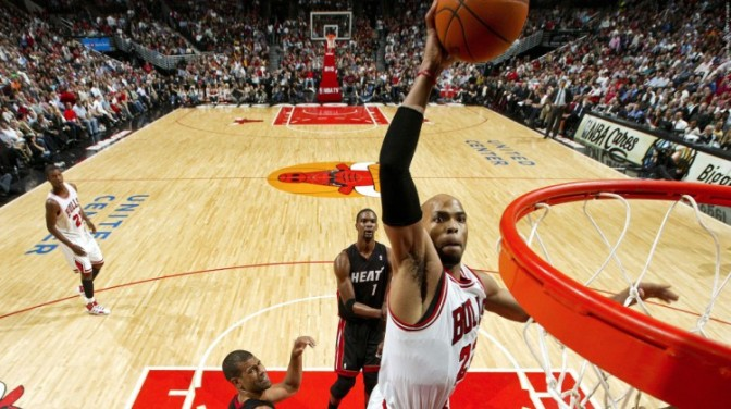 CHICAGO, IL - MARCH 14:  Taj Gibson #22 of the Chicago Bulls goes for a dunk against the Miami Heat on March 14, 2012 at the United Center in Chicago, Illinois. NOTE TO USER:  User expressly acknowledges and agrees that, by downloading and or using this Photograph, user is consenting to the terms and conditions of the Getty Images License Agreement.  Mandatory Copyright Notice:  Copyright 2012 NBAE (Photo by Joe Murphy/NBAE via Getty Images)