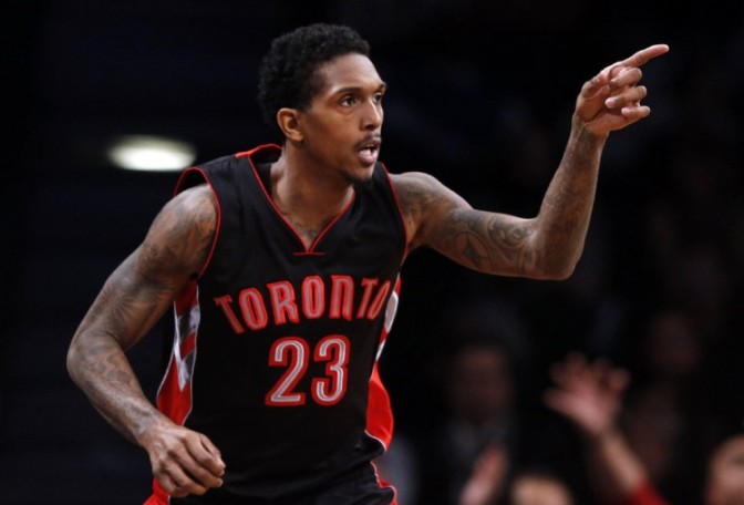 Toronto Raptors' Lou Williams (23) reacts after scoring against the Brooklyn Nets during overtime of an NBA basketball game Friday, Jan. 30, 2015, in New York.Toronto defeated Brooklyn 127-122 in overtime. (AP Photo/Jason DeCrow)