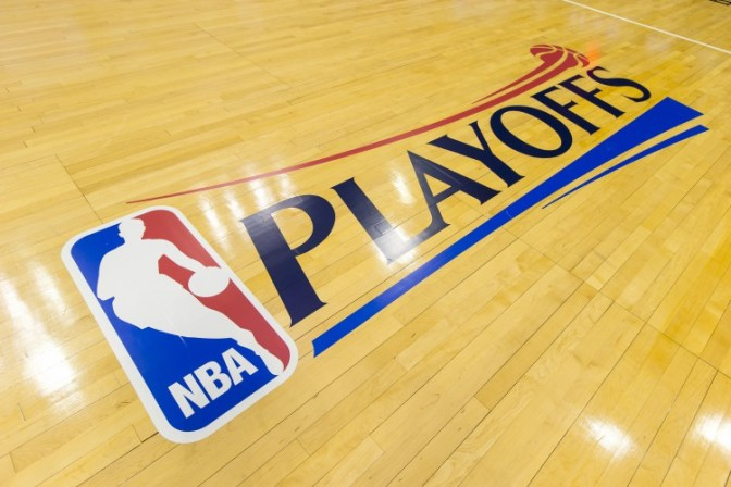 Apr 28, 2013; Milwaukee, WI, USA; The NBA Playoffs logo on the floor prior to game four of the first round of the 2013 NBA playoffs between the Miami Heat and Milwaukee Bucks at the BMO Harris Bradley Center. Mandatory Credit: Jeff Hanisch-USA TODAY Sports