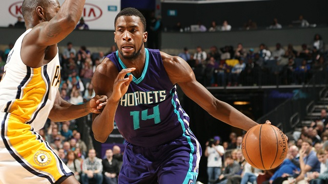CHARLOTTE, NC - JANUARY 17: Michael Kidd-Gilchrist #14 of the Charlotte Hornets drives against the Indiana Pacers during the game at the Time Warner Cable Arena on January 17, 2015 in Charlotte, North Carolina. NOTE TO USER: User expressly acknowledges and agrees that, by downloading and or using this photograph, User is consenting to the terms and conditions of the Getty Images License Agreement. Mandatory Copyright Notice: Copyright 2015 NBAE (Photo by Kent Smith/NBAE via Getty Images)